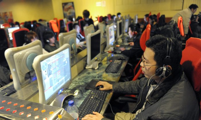 A young man plays an online game at a Internet cafe in Beijing on Feb. 27, 2010. (Liu Jin/AFP/Getty Images)