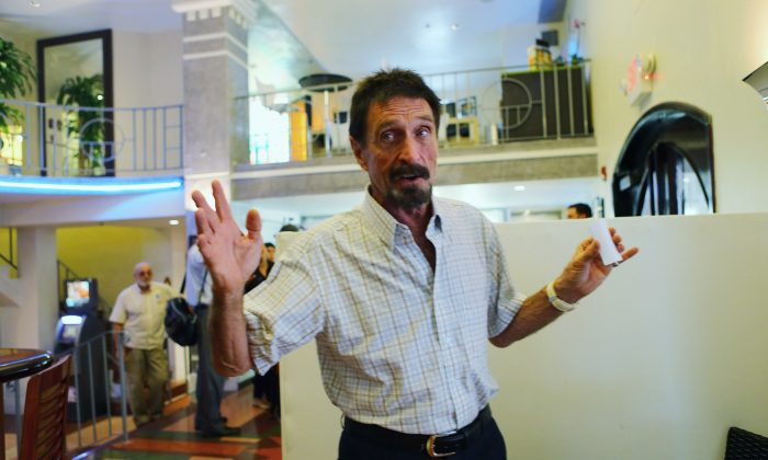 John McAfee talks to the media at the Beacon Hotel where he is staying after arriving last night from Guatemala on December 13, 2012 in Miami Beach, Florida. (Photo by Joe Raedle/Getty Images)