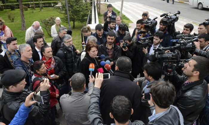 Dutch journalist Frederike Geerdink (C) answers journalists' questions as she leaves Diyarbakir courthouse on April 8, 2015, in Diyarbakir. (Ilyas Akengin/AFP/Getty Images)