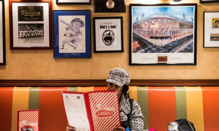 A woman looks at the menu in Brooklyn borough of New York City. (Andrew Burton/Getty Images)