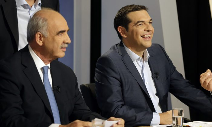 The leader of the left-wing Syriza party and former Greek Prime Minister Alexis Tsipras laughs as main opposition conservative New Democracy head Vangelis Meimarakis waits for the start of a live televised debate at the state-run ERT television in Athens, Wednesday, Sept. 9, 2015. (AP Photo/Thanassis Stavrakis)