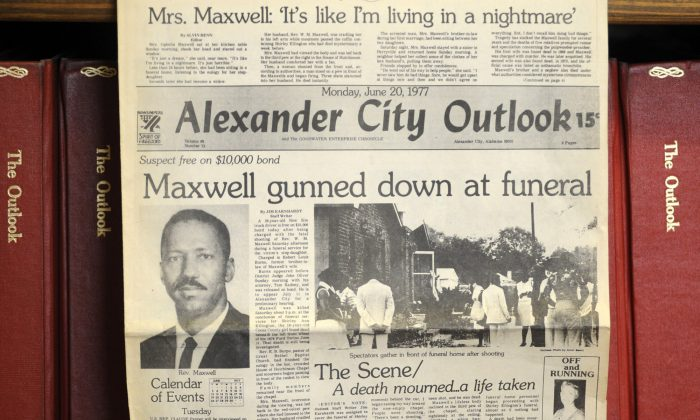 """This photograph taken Thursday, Aug. 27, 2015, in Alexander City, Ala., shows the front page of the town newspaper following the slaying of Willie Maxwell in 1977. """"To Kill a Mockingbird"""" author Harper Lee researched his slaying and a string of other killings, but no book was ever published. (AP Photo/Jay Reeves)"""