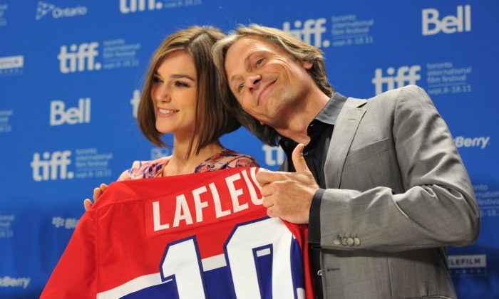 """Keira Knightley and Viggo Mortensen receive a LaFleur jersey at the """"A Dangerous Method"""" press conference at TIFF Bell Lightbox on Sept. 10, 2011. Mortensen is a big Habs fan. (Alberto E. Rodriguez/Getty Images)"""
