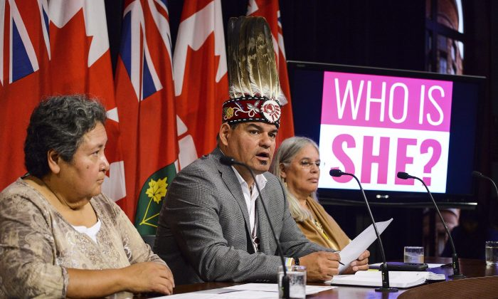 """(L-R) Deputy Grand Chief Denise Stonefish, Ontario Regional Chief Isadore Day, and Chief Ava Hill announce a new campaign called """"Who is She"""" at the Ontario Legislature in Toronto on Sept. 9, 2015. The campaign will help raise funds and awareness for the implementation of an Ontario First Nations-led inquiry process into missing and murdered Indigenous women and girls. (The Canadian Press/Aaron Vincent Elkaim)"""