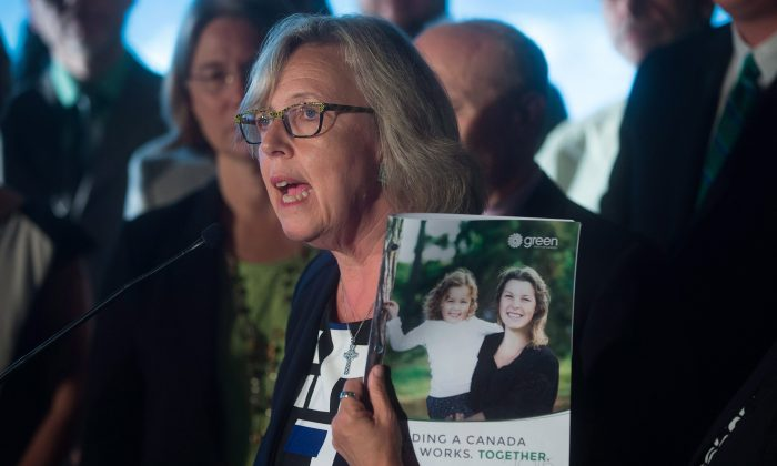 Green Party Leader Elizabeth May holds a copy of her party's platform during a campaign event in Vancouver on Sept. 9, 2015. The election will be held on Oct. 19. (The Canadian Press/Darryl Dyck)