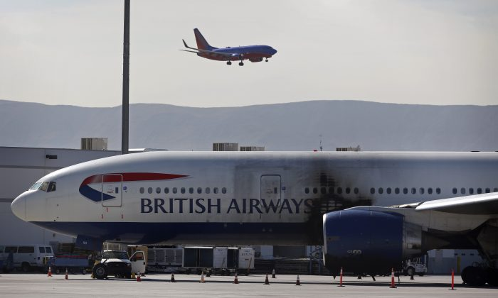 A damaged British Airways Boeing 777-200 sits at McCarran International Airport Wednesday, Sept. 9, 2015, in Las Vegas. (AP Photo/John Locher)