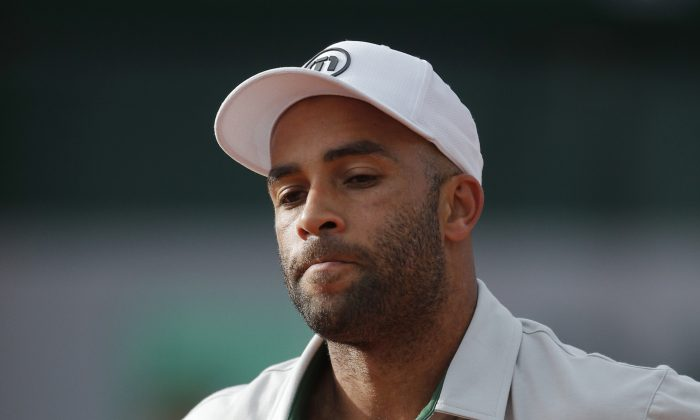 In this May 26, 2013, file photo, James Blake grimaces after missing a return against Serbia's Viktor Troicki at the French Open tennis tournament in Paris. (AP Photo/Michel Spingler)