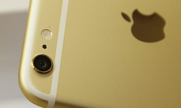 The camera and flash of an Apple iPhone 6 Plus gold, is shown here at a Verizon store on September 18, 2014 in Orem, Utah. (Photo by George Frey/Getty Images