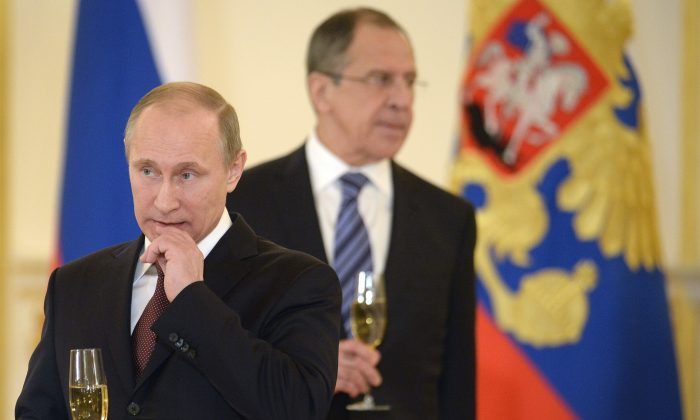 Russia's President Vladimir Putin (L) and Foreign Minister Sergei Lavrov attend a ceremony of receiving foreign ambassadors' credentials in Grand Kremlin Palace in Moscow, on January 16, 2014. (Alexander Nemenov/AFP/Getty Images)