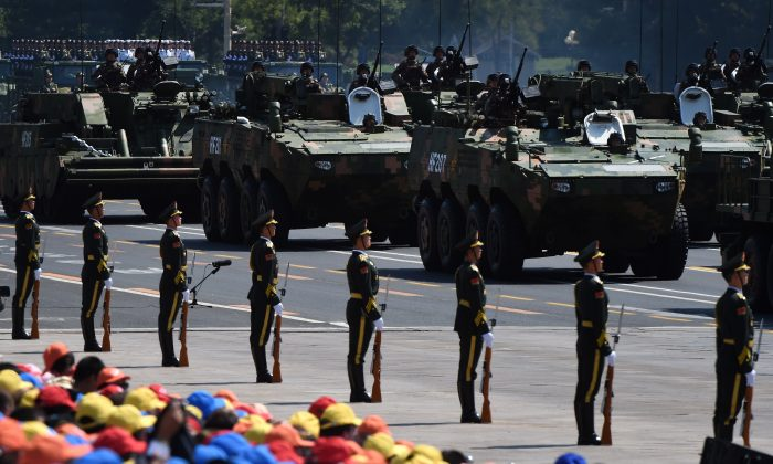Members of the Chinese regime's People's Liberation Army participate in a large-scale military parade in Beijing on Sept. 3, 2015. (Greg Baker/AFP/Getty Images)
