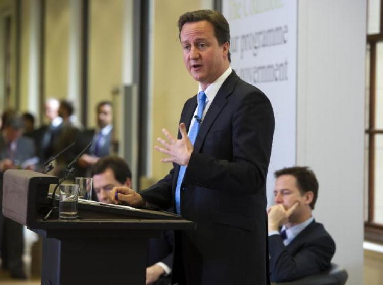 British David Cameron (standing) with Deputy Prime Minister Nick Clegg (right) at the launch of the British Government's Programme Coalition Agreement document in London, May 20, 2010.  (Roland Hoskins - WPA Pool/Getty Images)