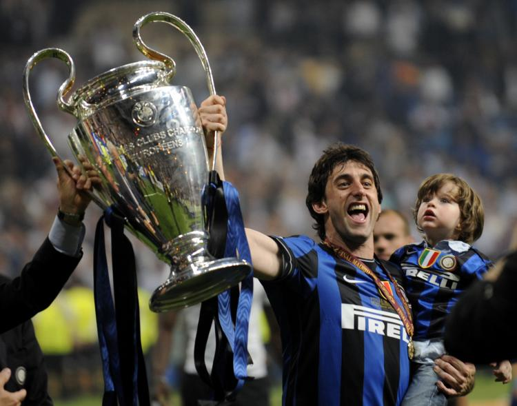 SPAIN: Inter Milan's Argentinian forward Diego Milito celebrates with the trophy after winning the UEFA Champions League final football match Inter Milan against Bayern Munich at the Santiago Bernabeu stadium in Madrid (PIERRE-PHILIPPE MARCOU/AFP/Getty Images)