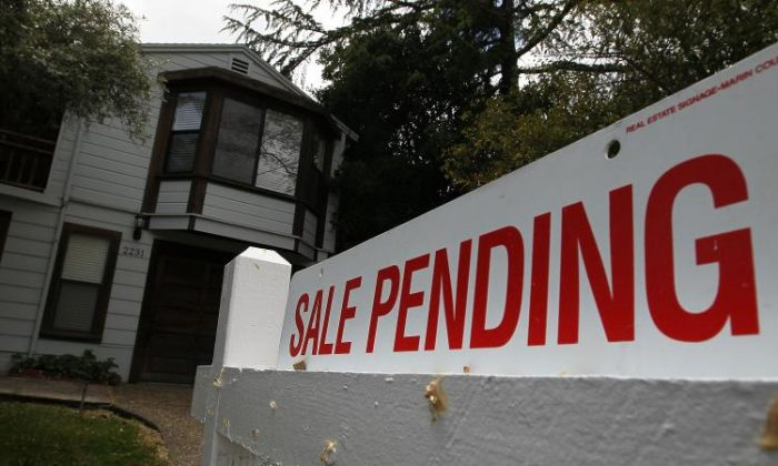 A 'sale pending' sign is displayed in front of a home for sale in San Rafael, Calif., on May 24, 2010. (Justin Sullivan/Getty Images)