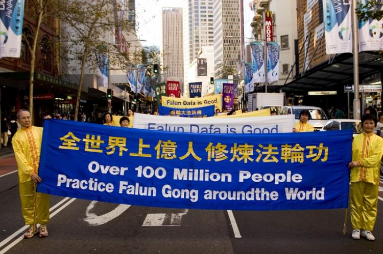 Falun Gong practitioners' 11 years of perseverance is to help people discover the truth.  (The Epoch Times)