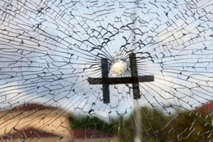 At approximately 3 p.m., Thursday Oct. 28, a shot pierced a hole in the large front window, splintering the glass. (Shan Ju Lin/The Epoch Times)