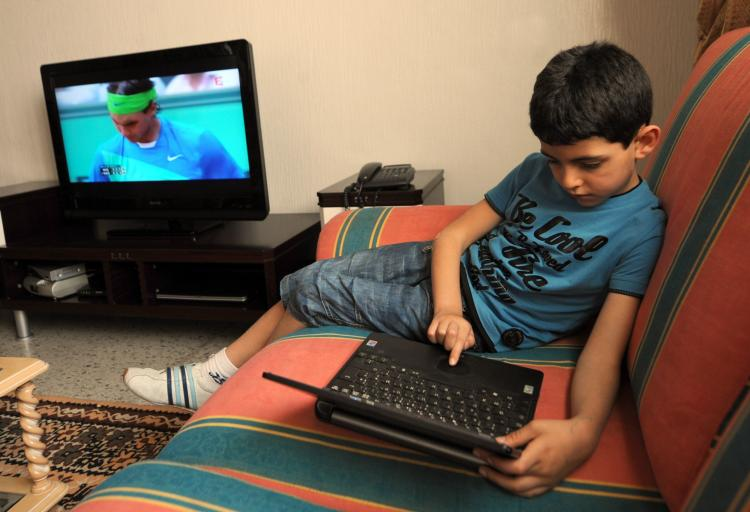 Kids exposed to the marketing of unhealthy foods through television, the Internet, and print ads are more likely to develop cardiovascular diseases, cancers, and diabetes later in life, says the World Health Organization. (Fethi Belaid/AFP/Getty Images)