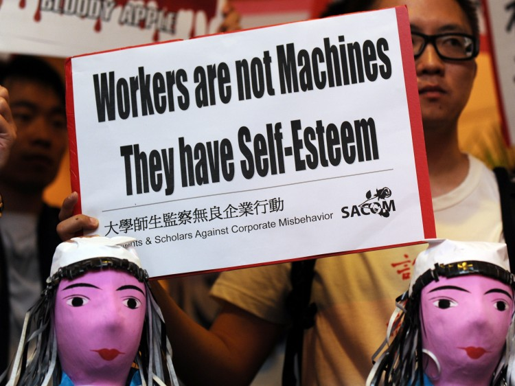 protest with model effigies of workers who have committed suicide at Foxconn