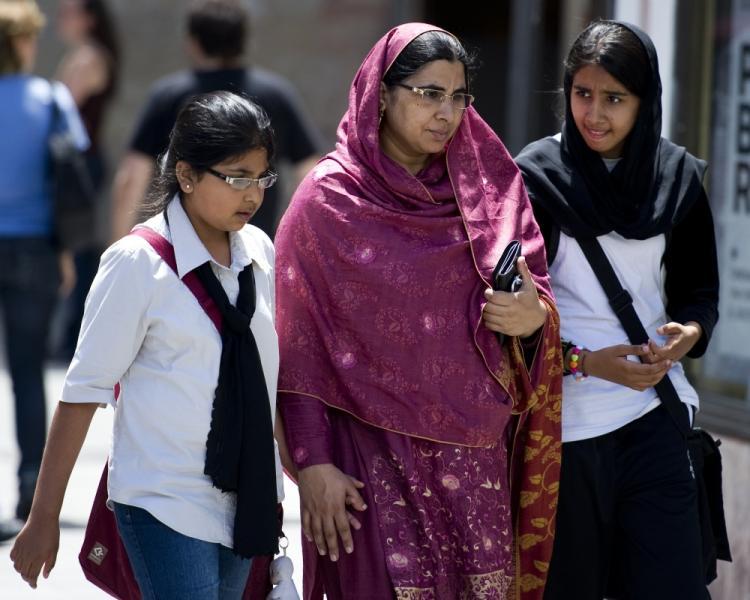 Women wearing head scarfs walk in Barcelona on June 16, 2010. (Josep Lago/AFP/Getty Images)