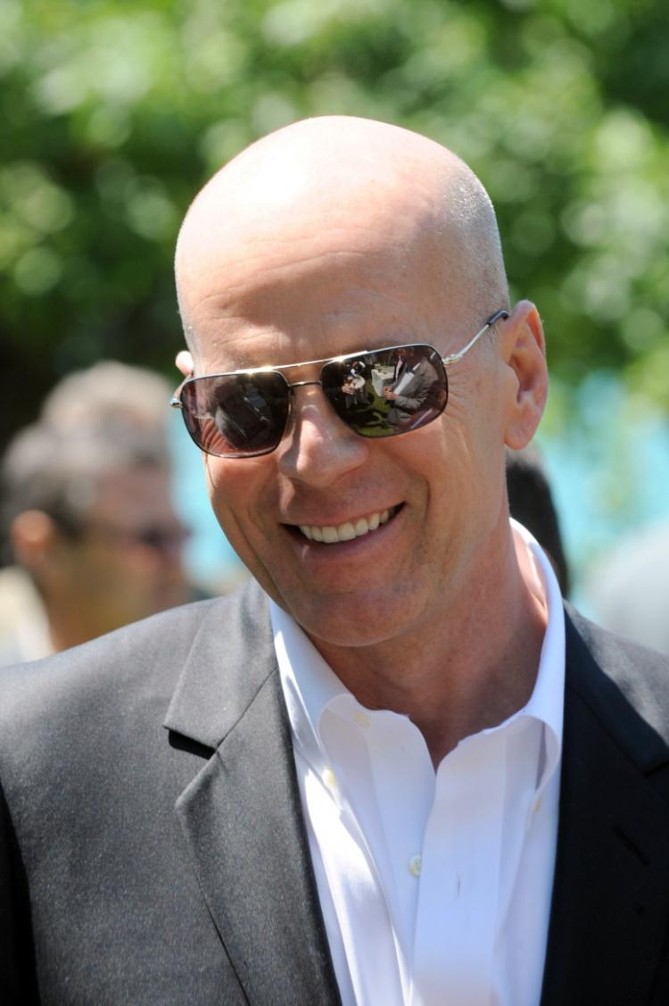 US actor Bruce Willis, shareholder of the French Belvedere Group, arrives to attend the general assembly of the wine and spirit company on June 25, 2010 in Talloires, eastern France. (Jean-Pierre Clatot/AFP/Getty Images)