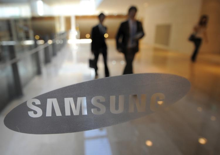 A Samsung logo is shown on the door of the company's main office in Seoul on July 7, 2010.   (Park Ji-Hwan/Getty Images)