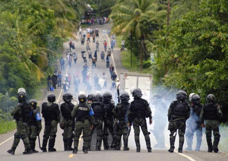 Policemen throw tear gas during clashes in Changuinola, Bocas del Toro, Panama on July 10. A strike was approved by Panamanian workers for next Tuesday against a law reform launched by the government of Ricardo Martinelli.  (Bienvenido Velasco/Getty Images)
