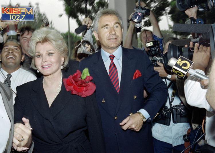 Zsa Zsa Gabor, flanked by her husband, Prince Frederick von Anhalt, Germany's duke of Saxony, enters Beverly Hills Municipal Court on Sept. 11, 1989. Gabor left the hospital for her Bel Air mansion on Saturday following a leg amputation. (Wade Byars/AFP/Getty Images)