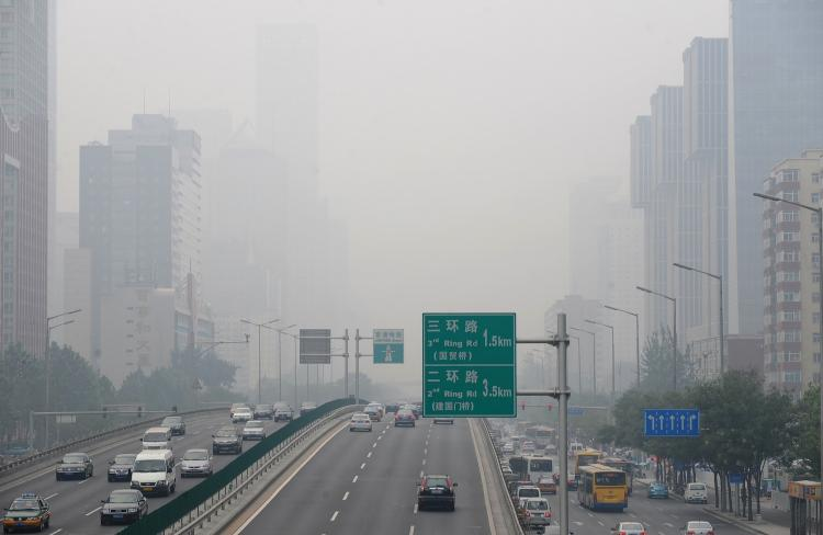 As vehicles travel through central Beijing, smog is seen hovering over the city. According to the Ministry of Environmental Protection's director, more than 30 percent of China's urban population lives in areas with poor air quality, and that pollution is especially bad between Beijing and Shanghai. (Frederic J. Brown/Getty Images)