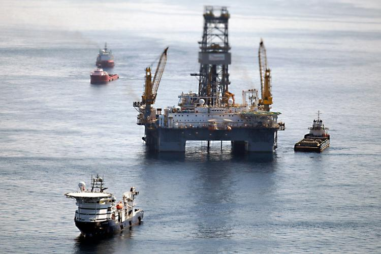 LOOKING FOR OIL: Ships work near the site of the BP Deepwater Horizon oil spill on Aug. 3, 2010 off the coast of Louisiana. BP will reportedly resume deepwater drilling in the Gulf of Mexico, after striking a deal with federal regulators. (Chris Graythen/Getty Images)