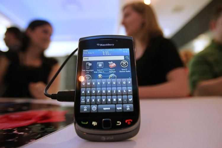 The Blackberry Torch 9800 smartphone is on display in New York City. On Thursday Research in Motion (RIM) launched the latest version of its instant messaging and social network platform, Blackberry Messenger (BBM). (Mario Tama/Getty Images)