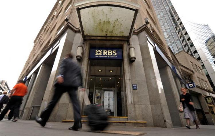 People walk past a branch of the Royal Bank of Scotland (RBS), in the City of London on August 4, 2010.  (Ben Stansall/Getty Images)