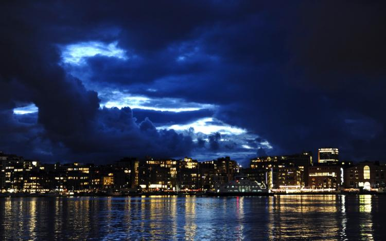 Skyline in Oslo, rated the most expensive city, at the Norwegian capital's waterfront and entertainment area, as a break in the cloud cover lets light in, at dusk.  (Odd Andersen/Getty Images )
