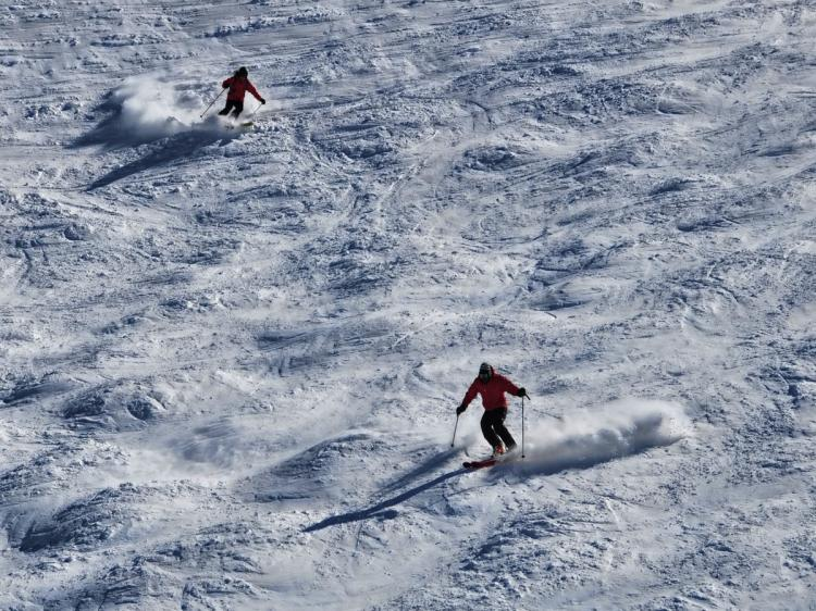 Skiers descend a mountain at Valle Nevado skiing centre in the Andes Mountains, some 50 km from Santiago, on August 13, 2010. (Martin Bernetti/AFP/Getty Images)