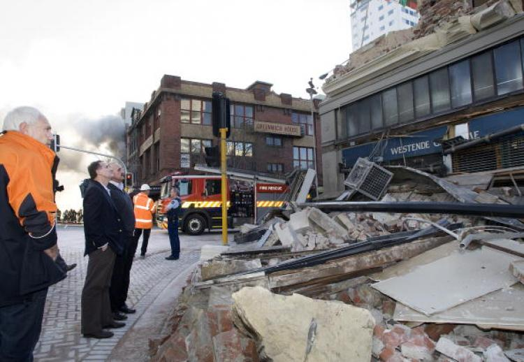 (L-R) Christchurch Mayor Bob Parker and New Zealand Prime Minister John Key look at a collapsed building in Manchester Street after a 7.1 magnitude earthquake struck 30km west of the city at 4:35 am this morning Sept. 4, in Christchurch. (Joseph Johnson/Getty Images)
