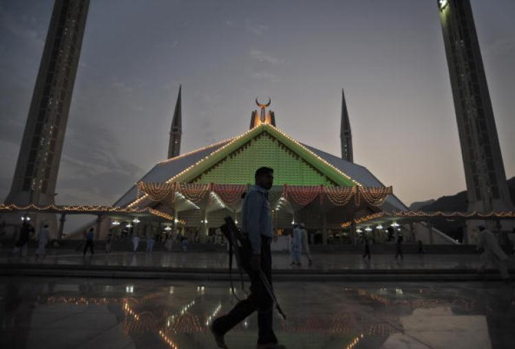 A Pakistani policeman patrols at the Faisal Mosque in Islamabad on September 6. Islamabad Police announced that it will formally charge three men connected to Faisal Shahzad, the would-be Times Square car bomber. (Farooq Naeem/Getty Images)