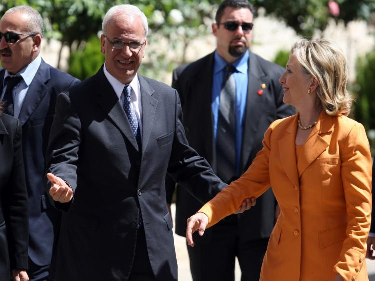Palestinian peace negotiator Saeb Erakat welcomes US Secretary of State Hillary Clinton at the Palestinian Authority headquarter in the West Bank city of Ramallah on September 16, 2010. (Abbas Momani/AFP/Getty Images)