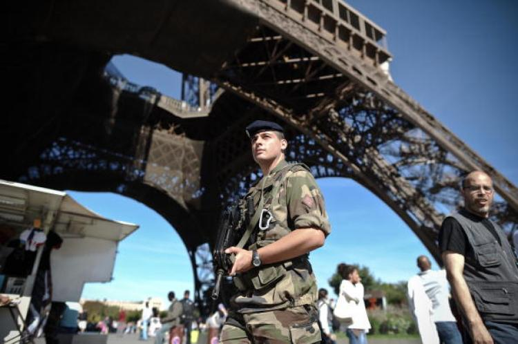 A French Army soldier is on patrol as part of France's national security alert system Vigipirate at the Eiffel Tower in Paris, on September 20.  (Fred Dufour/Getty Images)