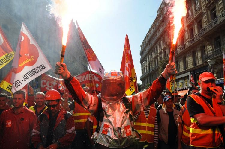 French unions staged mass protests and strikes on Sept. 23, in Marseille, hoping to bring more than two million onto the streets to defy President Nicolas Sarkozy's retirement reform plan to hike the retirement age to 62.  (Anne-Christine Poujoulat/Getty Images)