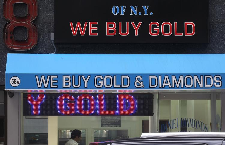 A sign reading 'We Buy Gold & Diamonds' is displayed in the Diamond District September 29, 2010 in New York City. (Mario Tama/Getty Images)