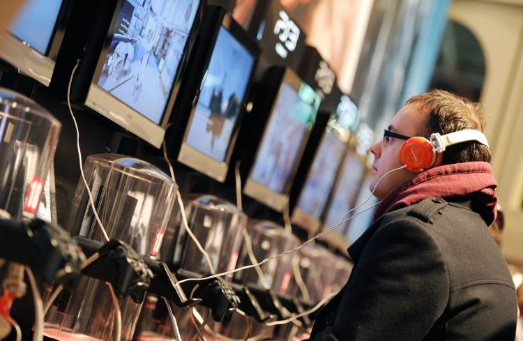A man plays on a PS3 games console last October in Paris. Sony said on Tuesday that hackers may have been able to access personal information of more than 77 million PlayStation Network customers, including passwords, purchase history, and billing address. (Franck Fife/Getty Images)