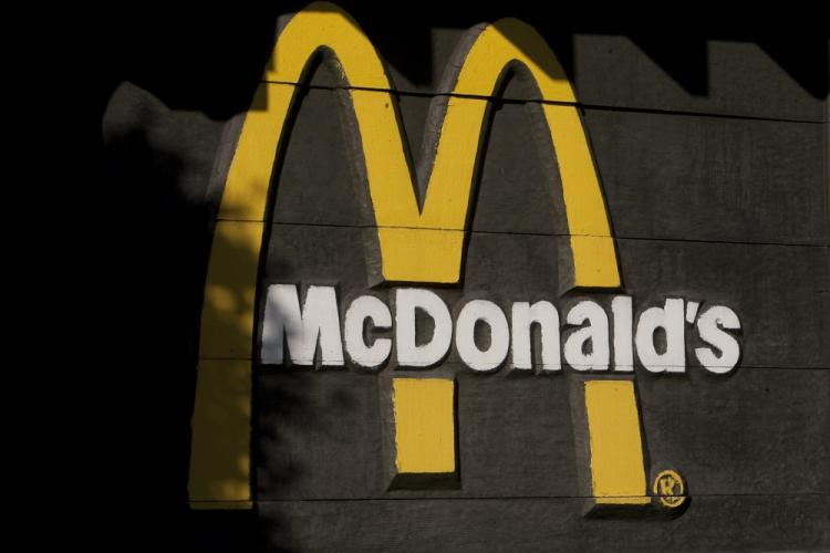 McRib and coffee sales boosted McDonald's fourth quarter earnings. The McDonald's logo is seen outside a McDonald's restaurant on November 3, 2010 in San Francisco, California. (David Paul Morris/Getty Images)