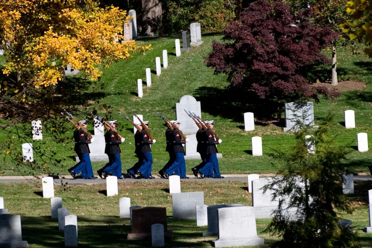 Members of the US Marine Corps Honor Guard march through Arlington National Cemetery