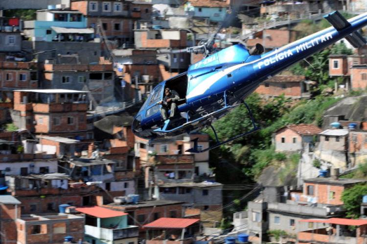A military helicopter overflies the Morro do Alemao shantytown, during the raid on Nov. 28, 2010 in Rio de Janeiro, Brazil.  (Evaristo Sa/AFP/Getty Images)