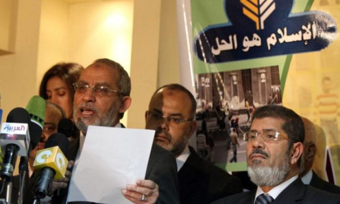 Mohammed Badie (L), the head of Egypt's Muslim Brotherhood, holds a press conference. (file, Khaled Desouki/AFP/Getty Images)