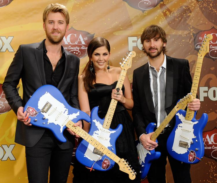 Lady Antebellum's (L-R) Charles Kelley, Hillary Scott, and Dave Haywood pose at the American Country Awards on Dec. 6, 2010 in Las Vegas. The country trio won Song of the Year and Best Country Album at the 53rd annual Grammy Awards on Feb. 13. (Ethan Miller/Getty Images)
