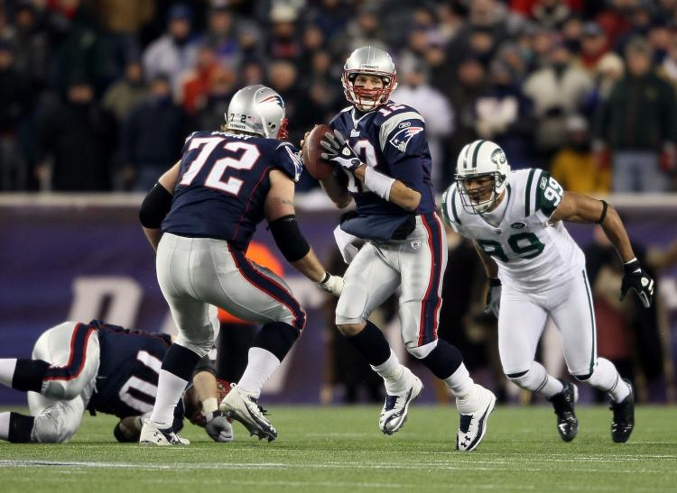 Tom Brady of the New England Patriots looks to pass against the New York Jets at Gillette Stadium on Dec. 6, 2010 in Foxboro, Massachusetts.