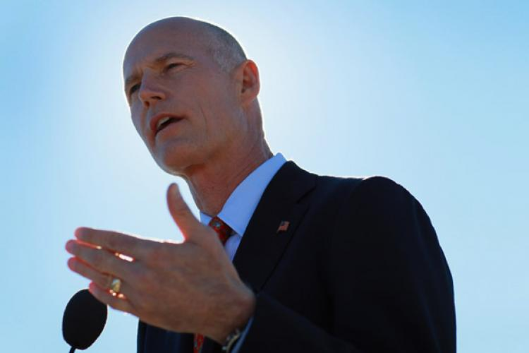 Florida Governor-elect Rick Scott speaks at a press conference on the Port of Miami on December 8, 2010 in Miami, Florida. Scott announced on Feb. 16 that after careful consideration he has decided to reject President Obama's plan for a high-speed rail project that would link Tampa to Orlando. (Joe Raedle/Getty Images)