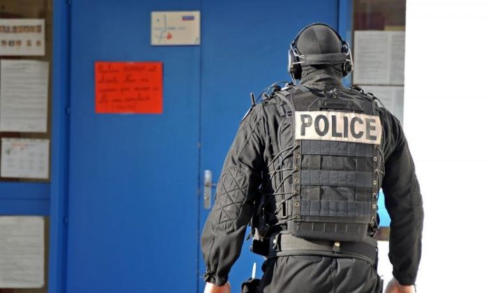 A member of French National Police Intervention Group forces (GIPN) walks in the nursery school, where a sword-wielding teenager was holding five children and a teacher on Dec. 13 in Besancon, France. (Harold Cunningham/Getty Images)