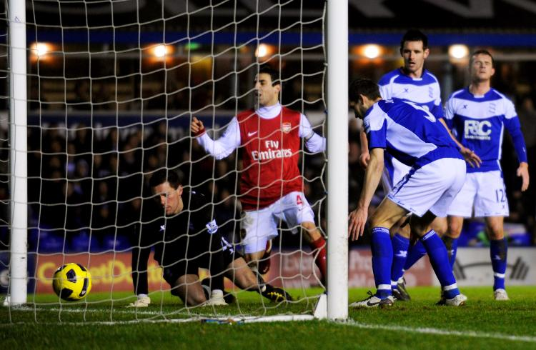 Birmingham concede a third goal to Arsenal as Roger Johnson scores an own goal past his goalkeeper Maik Taylor (L) at St. Andrews on Jan. 1 in Birmingham. (Michael Regan/Getty Images)