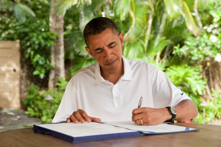 President Obama signs H.R. 847, the 'James Zadroga 9/11 Health and Compensation Act' on January 2, 2011in Kailua, Hawaii. The bill provides health coverage to the workers that were affected at ground zero after helping others and clearing the rubble during 9/11. (Pete Souza/White House via Getty Images)