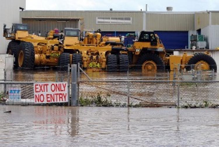 Giant mining trucks are engulfed by flood waters near Rockhampton on January 6 (Getty Images)